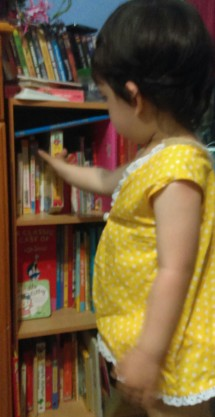 Happy Eco Toddler at her bookshelf!